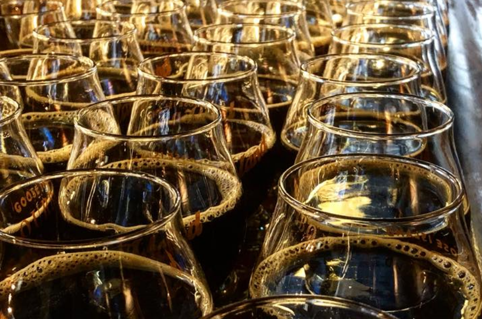 Image of many glasses of beer brewed at the Rock Island Brewing Company lined up and ready for serving